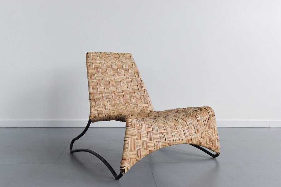 Vintage Rattan Weave Lounge Chair On Black Tubular Frame