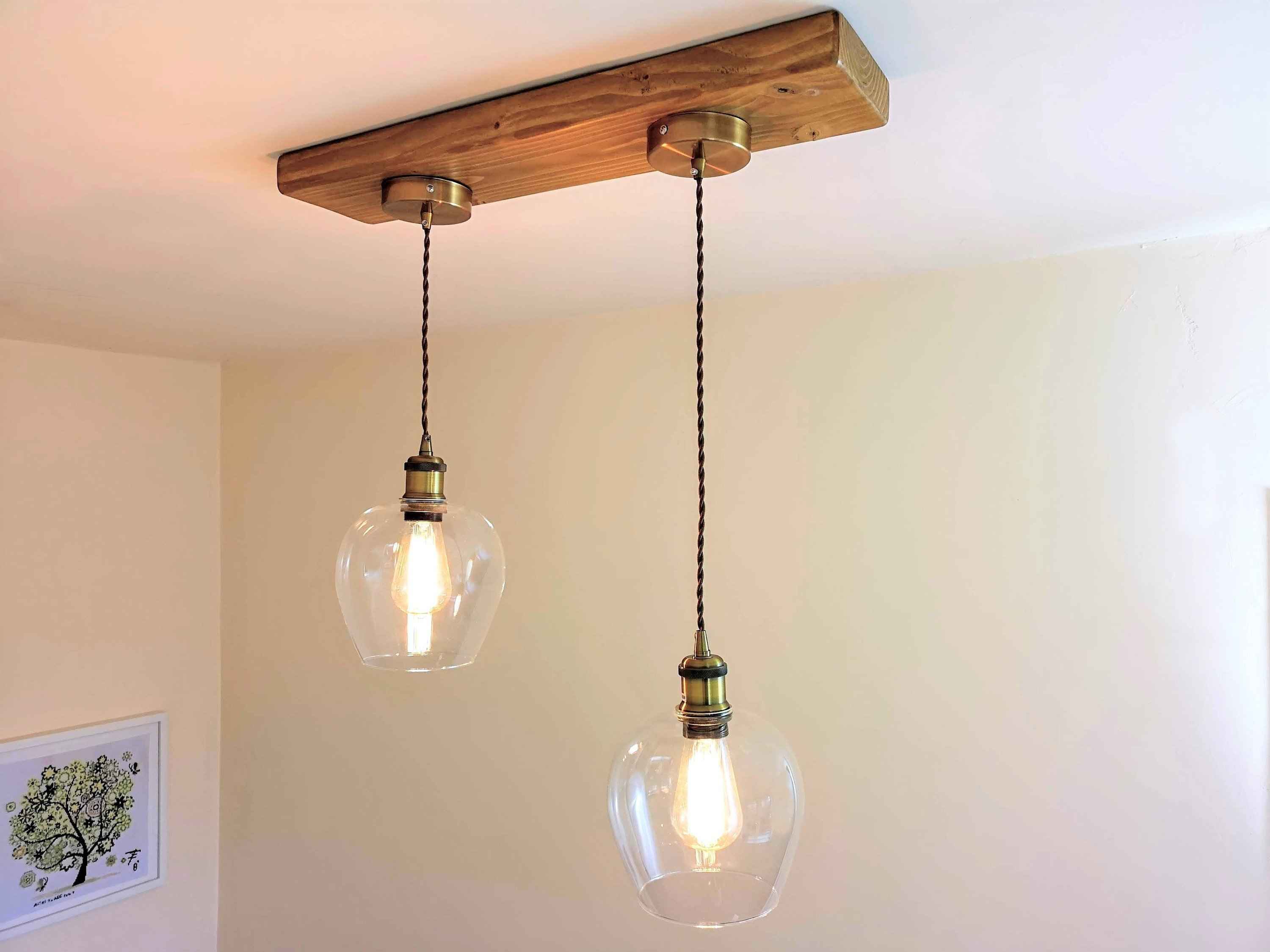 Industrial ceiling light designer brass lamp holders with glass bell shaped shades on a timber base modern pendant light fitting