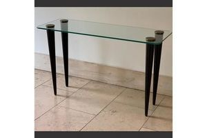 Thumb glass topped console in the manner of gilbert rohde 0
