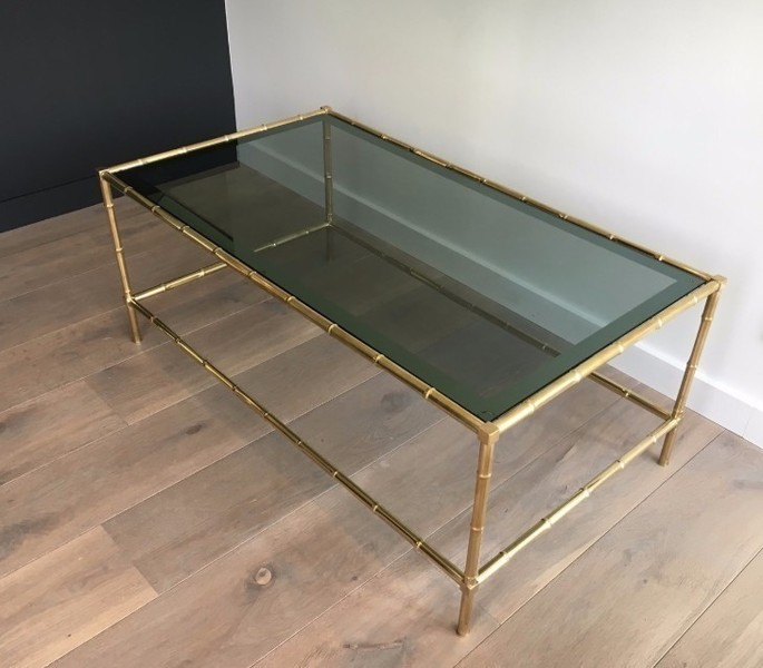 In The Style Of Jacques Adnet. Faux Bamboo Brass Coffee Table With Blueish Glass Top. Circa 1940
