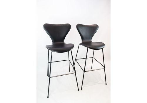 A Pair Of Seven Bar Stools, Model 3187/3197, By Arne Jacobsen And Fritz Hansen